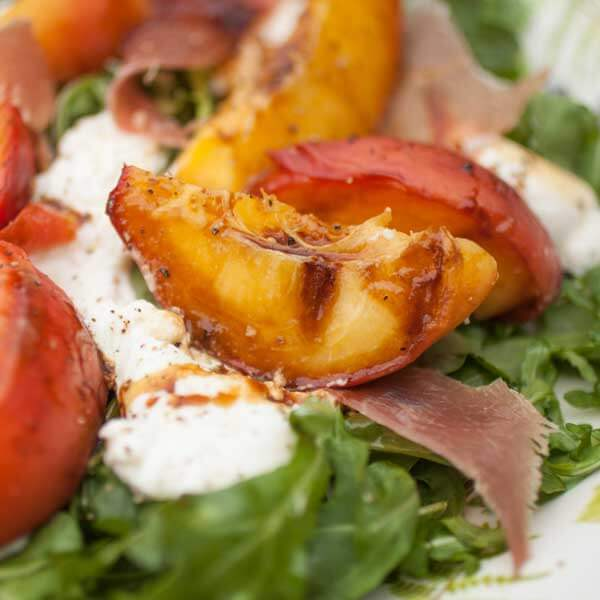 Enjoy fresh, local peaches with the Grilled Peach Salad recipe from Metropolitan Market